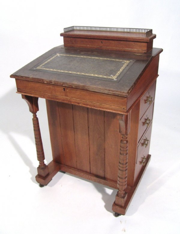 17: Victorian mahogany Davenport with brass galleried s
