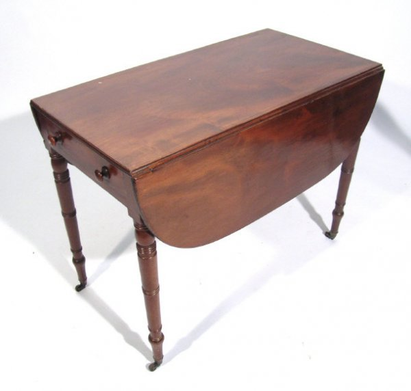 21: Victorian mahogany Pembroke table fitted with an en