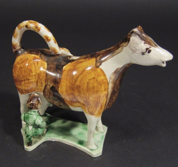 102: 19th century Staffordshire Whieldon style cow crea