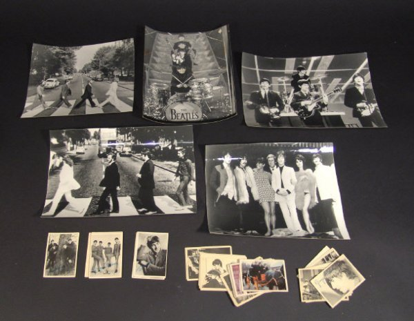 585: Five Beatles black and white press photographs and