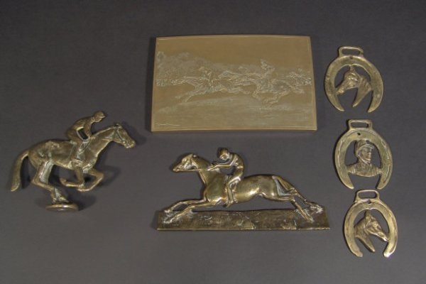 590: Brass horse racing items including a Fred Archer d