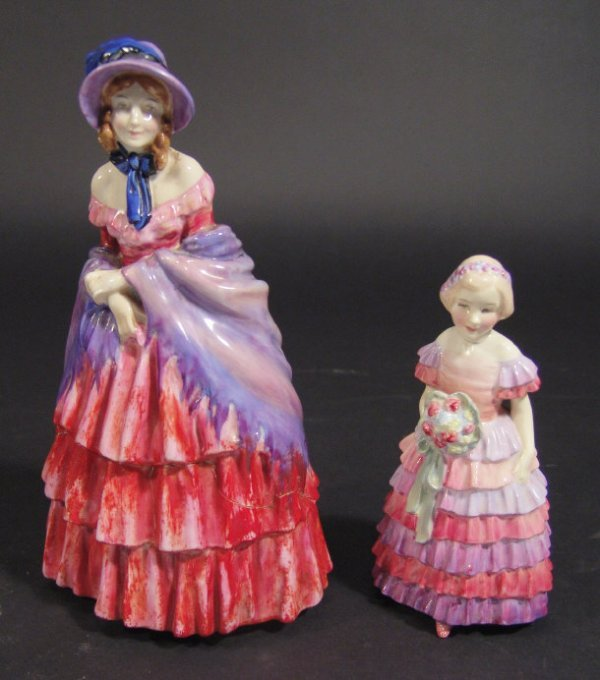 1214: Two Royal Doulton figurines, 'A Victorian Lady',