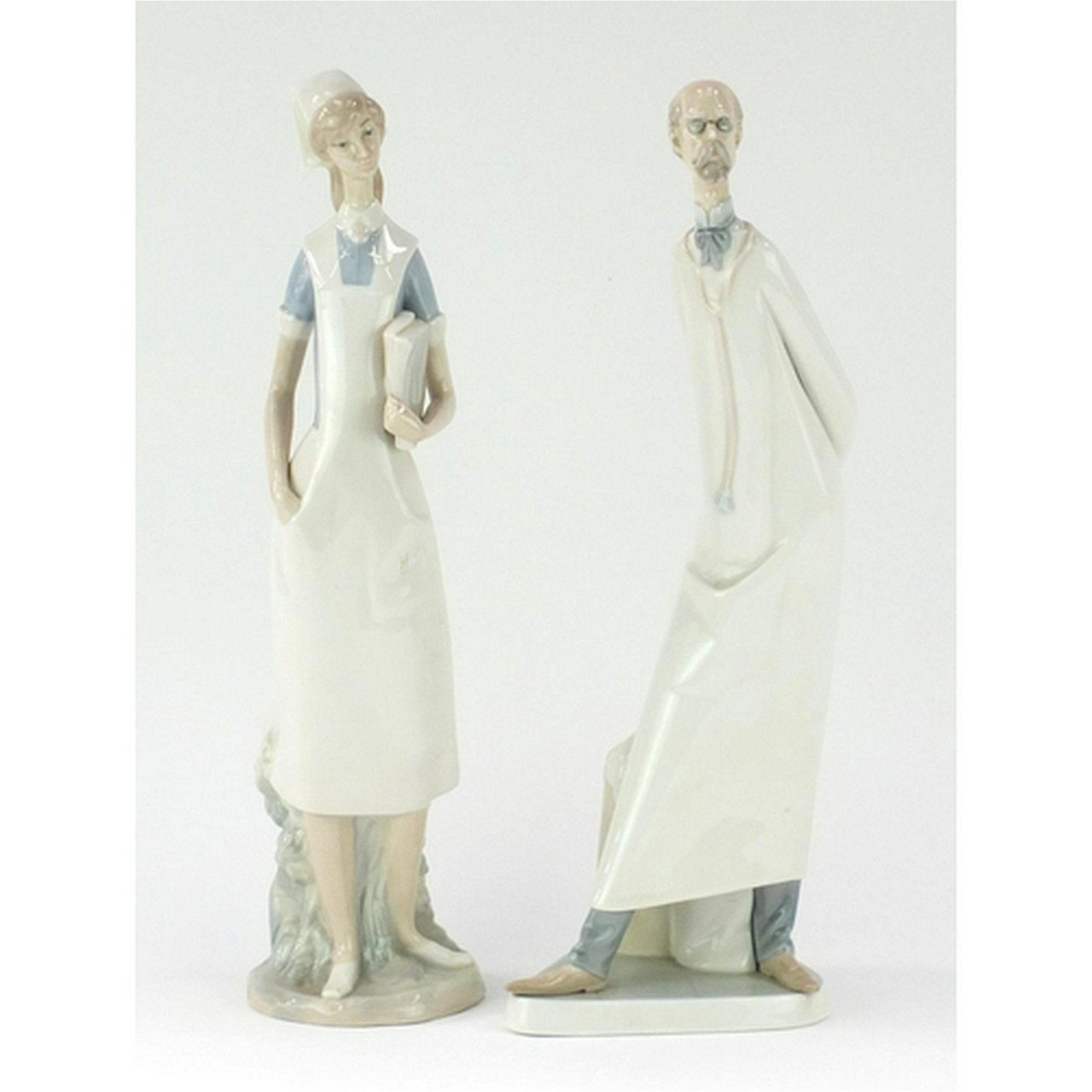 Two large Lladro figures of a doctor and nurse, each