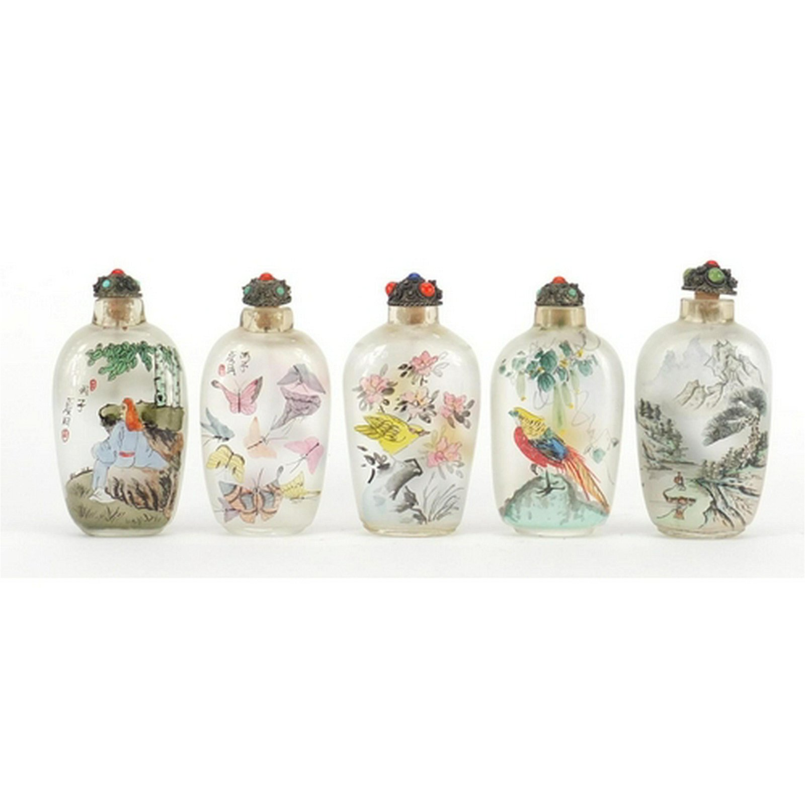 Five Chinese glass snuff bottles with stoppers, each