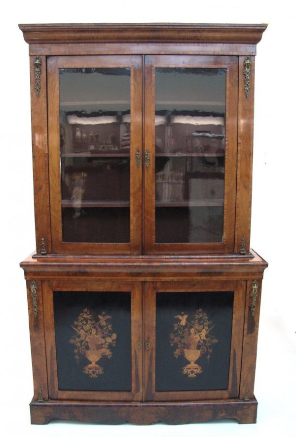 6: Victorian burr walnut bookcase fitted with a pair of
