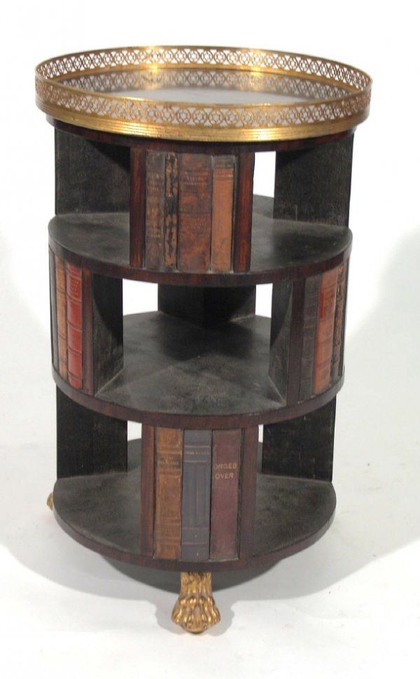 11: Circular three tier bookcase with a brass gallery,