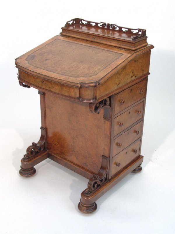 13: Victorian inlaid walnut Davenport fitted a hinged s