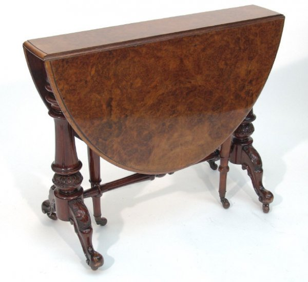 23: Victorian oval burr walnut Sutherland table, the to