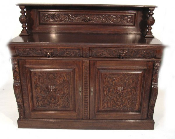 32: 1930s carved oak sideboard, the superstructure with