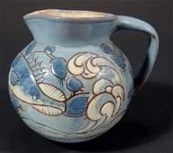 299: C.H. Brannam Barnstaple jug incised with a continu