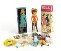 Two 1960's dolls with accessories and boxes comprising