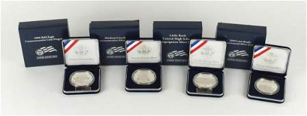 Four United States Mint silver proof dollars, with