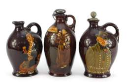 Three Royal Doulton Kingsware decanters including
