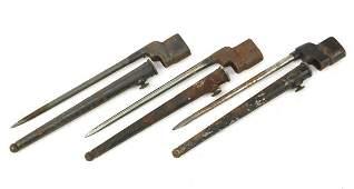 Three British military socket bayonets with scabbards,