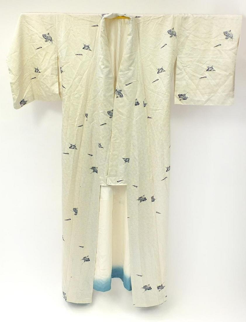 Japanese silk kimono decorated with fans