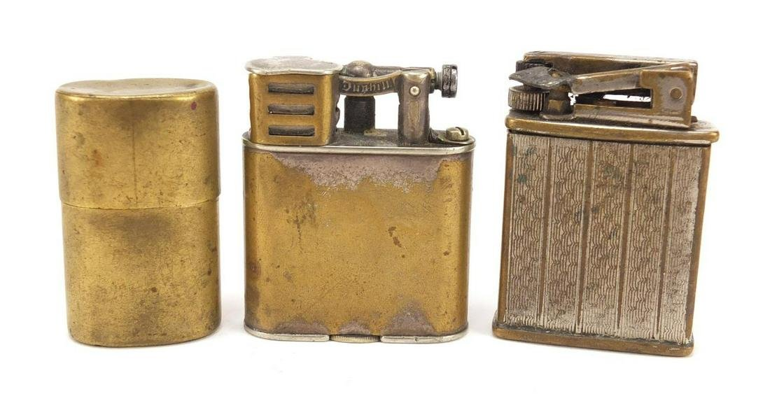 Three vintage lighters including a Dunhill example, the