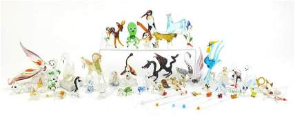 Collection of colourful glass animals including a bird