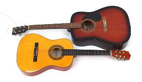 Two wooden acoustic guitars comprising Stagg and Herald