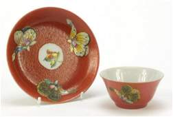 Chinese red ground porcelain tea bowl and saucer hand