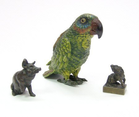 8: Painted lead parrot pen wipe, bronze study of a recu