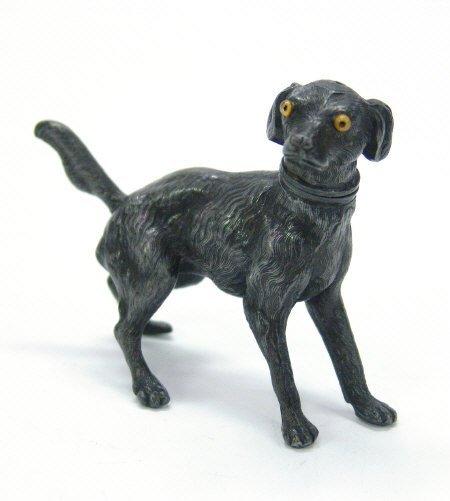 10: Novelty pewter startled dog pepperette set with gla
