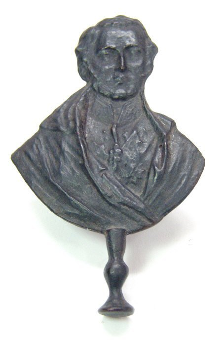 12: Cast metal pipe tamper in the form of a political b