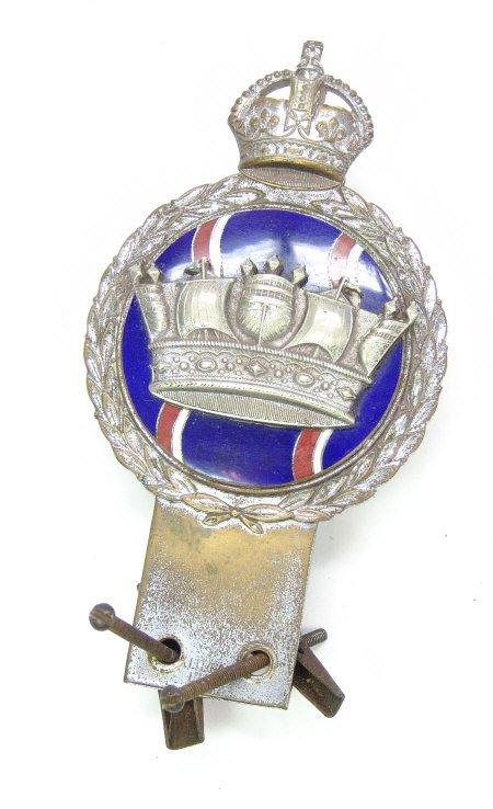 21: Chrome car radiator badge with enamel and ship deco