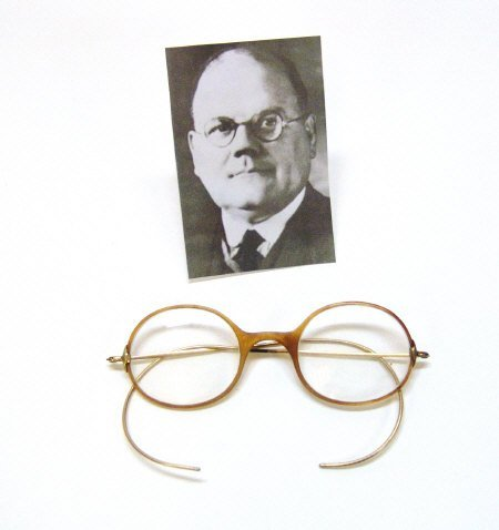 239: Pair of horn rimmed gold metal spectacles as worn