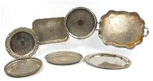 Seven silver plated serving trays including galleried