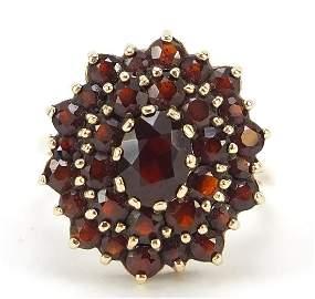 9ct gold garnet three tier cluster ring, size T, 6.4g