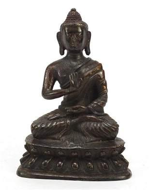 Chino-Tibetan partially gilt bronze figure of seated
