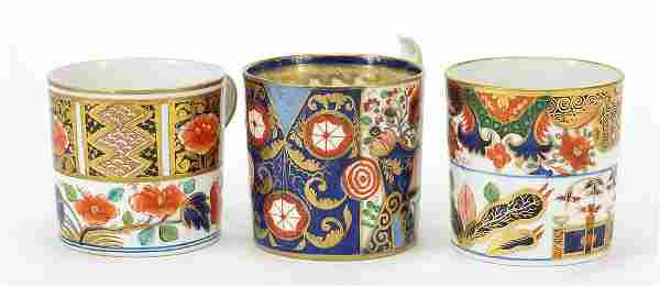 Three early 19th century Derby porcelain coffee cans