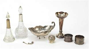 Silver items including two cut glass bottles with