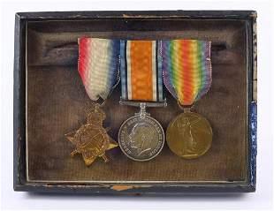 British military World War I trio housed in a glazed