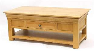 Contemporary light oak low table fitted with a double
