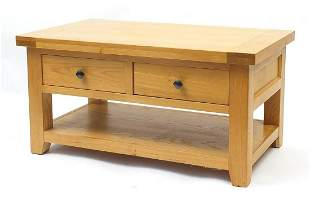 Contemporary light oak low table fitted with two frieze
