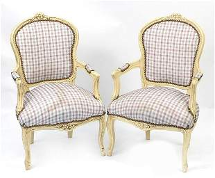 Pair of French style cream painted open armchairs with