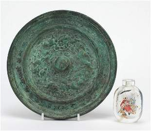 Chinese archaic style bronze mirror and a snuff bottle