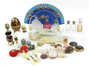 Objects including scent bottles, shells, compacts and a