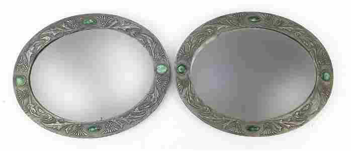 Manner of Liberty & Co, pair of Arts & Crafts oval wall