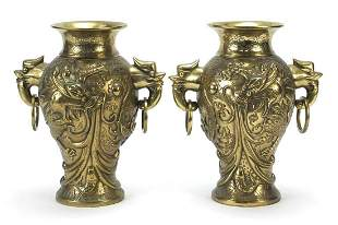 Pair of Chinese bronze vases with ring turned bird's