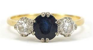 Unmarked gold, sapphire and diamond three stone ring,