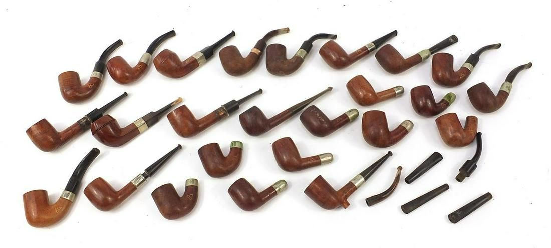 Collection of vintage smoking pipes mostly with silver