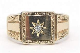 9ct gold on silver signet ring set with a clear stone,