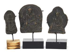 Three Nepalese patinated bronze plaques of Buddha with