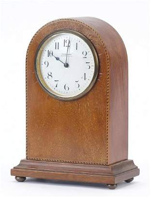 Line inlaid mahogany dome top mantle clock with enamel