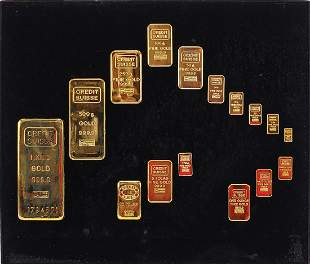 Sixteen decorative gold plated bars housed in a display