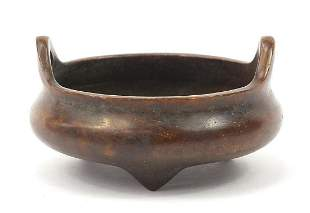 Chinese patinated bronze tripod censer with twin