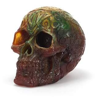 Amber coloured marbleised skull, 18cm in length