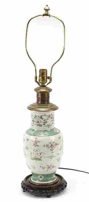Chinese porcelain vase lamp on carved hardwood stand,